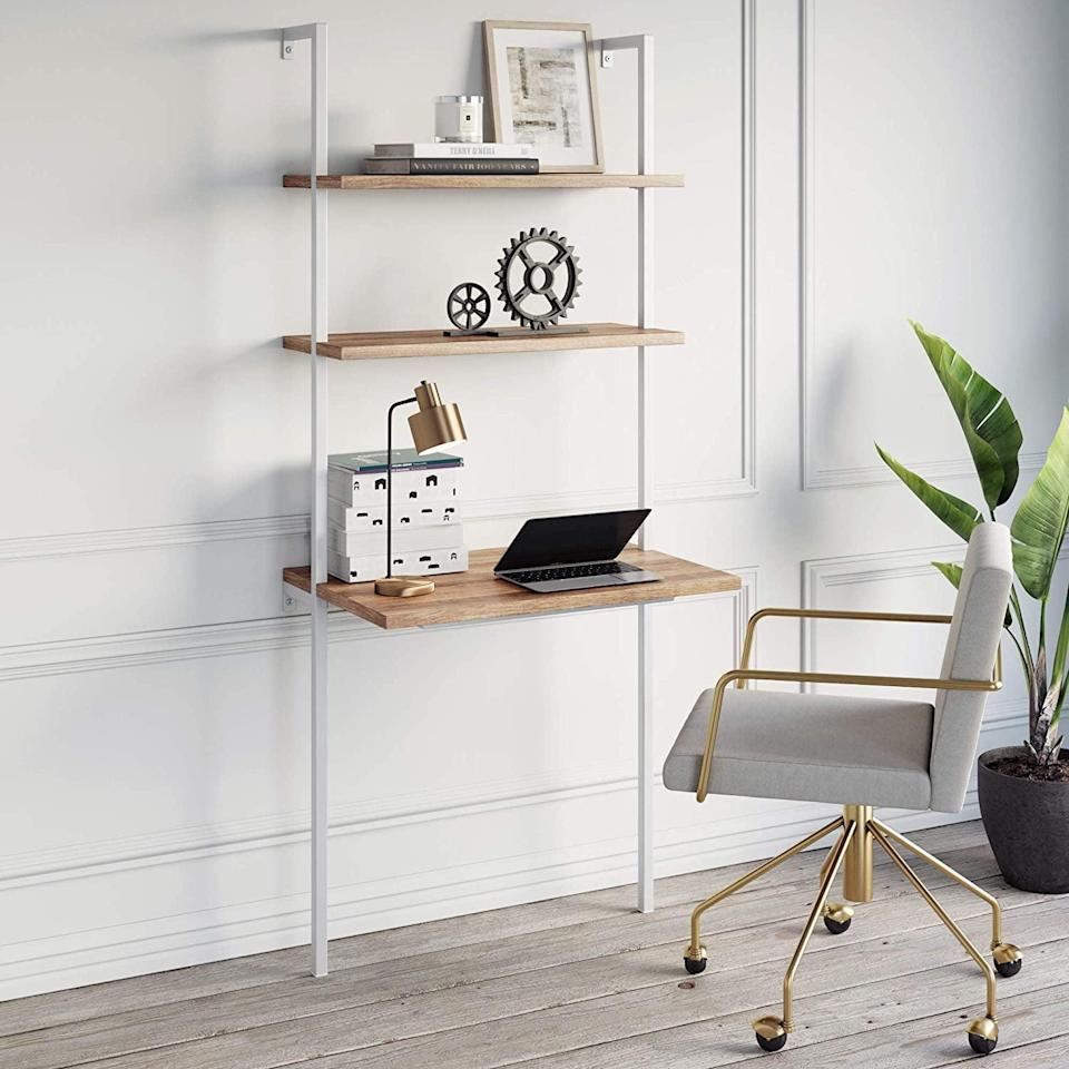 <p>This <span>Nathan James Theo 2-Shelf Industrial Wall Mount Ladder</span> ($138) includes both a desk and storage.</p>