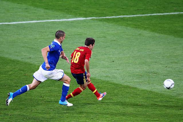 KIEV, UKRAINE - JULY 01: Jordi Alba of Spain scores his team's second goal in front of Leonardo Bonucci of Italy of Italy during the UEFA EURO 2012 final match between Spain and Italy at the Olympic Stadium on July 1, 2012 in Kiev, Ukraine. (Photo by Martin Rose/Getty Images)