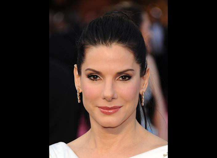 HOLLYWOOD, CA - FEBRUARY 26: Actress Sandra Bullock arrives at the 84th Annual Academy Awards at the Hollywood and Highland Center on February 26, 2012 in Hollywood, California. (Photo by Michael Buckner/Getty Images)