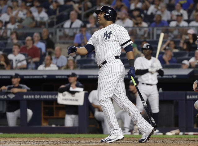 New York Yankees' Edwin Encarnacion follows through on a three-run double during the fifth inning of a baseball game against the Toronto Blue Jays, Friday, July 12, 2019, in New York. (AP Photo/Frank Franklin II)