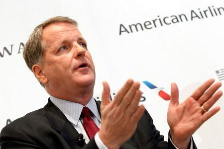 American Airlines CEO Doug Parker is seein during a news conference at Dallas-Ft Worth International Airport February 14, 2013. REUTERS/Mike Stone/File Photo