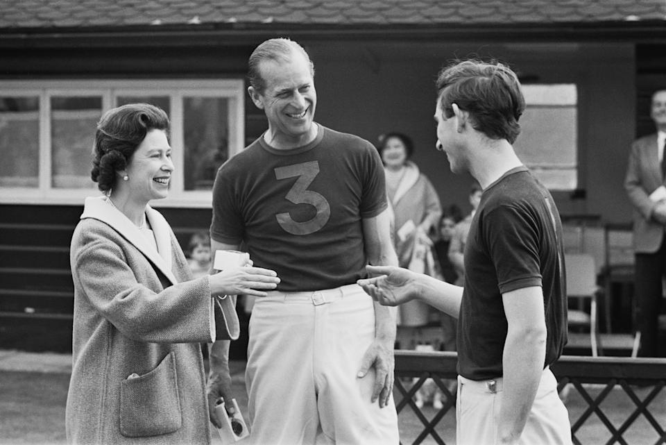 Queen Elizabeth awarding Philip and Charles with trophies after a polo match on April 30, 1967.