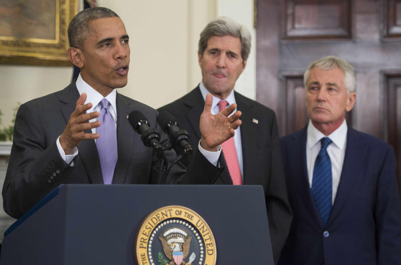 US President Barack Obama (L) deliver remarks on legislation he sent to Congress to authorize the use of military force against the Islamic State, in Washington on February 11, 2015