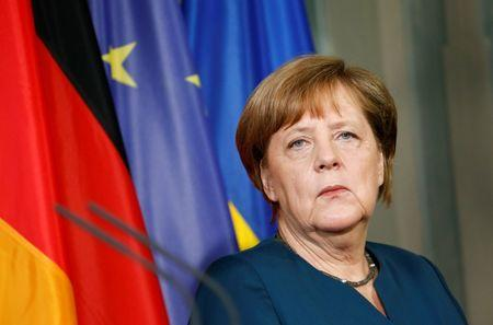 Merkel vows to fight terrorism with Britain after Manchester attack