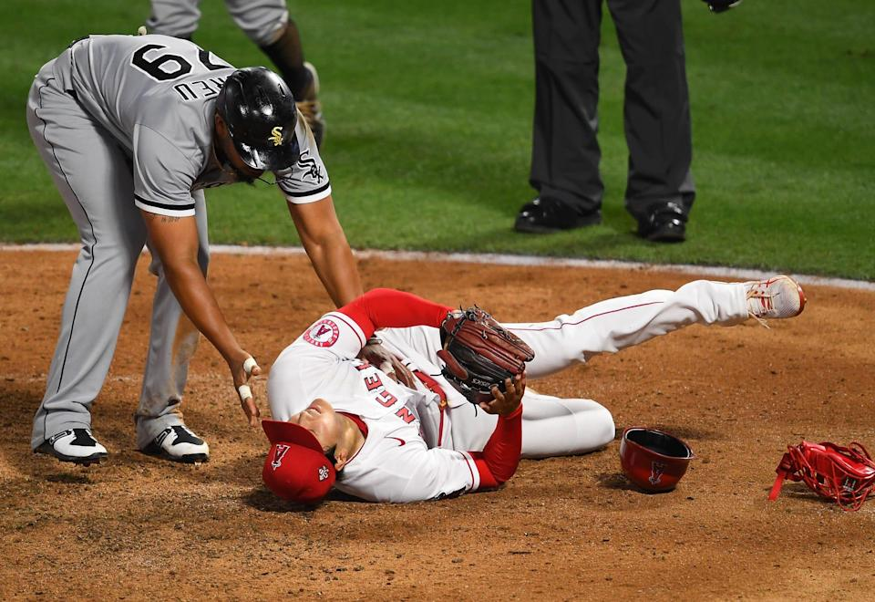 Chicago White Sox first baseman Jose Abreu checks on Los Angeles Angels pitcher Shohei Ohtani after a collision between the two at home plate.