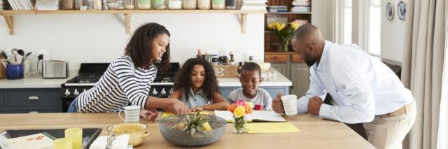 A Black family at the kitchen table