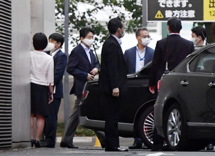 Japanese Prime Minister Shinzo Abe gets into a car as he leaves from Keio University Hospital in Tokyo