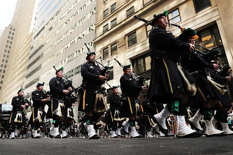 The NYPD Emerald Society Pipes and Drums band marches in a procession marking the 15th anniversary of the 9/11 attacks and the police officers who were killed (AFP Photo/Spencer Platt)