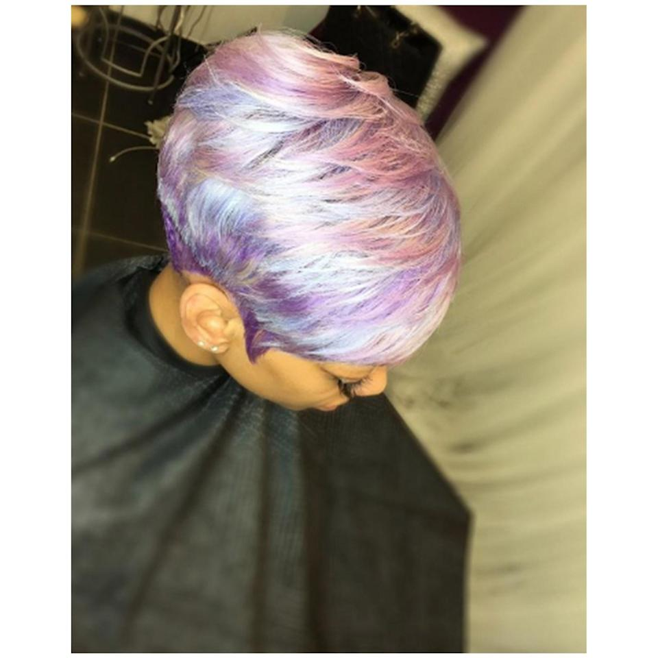 This dye job by Atlanta-based stylist Latise Stewart uses iridescent pinks, purples, and blues for the prettiest pixie.