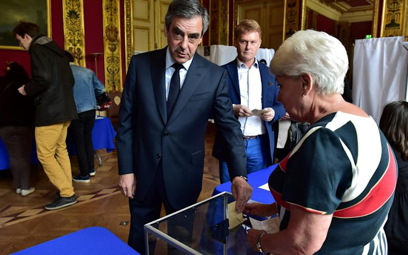 Francois Fillon, member of the Republicans political party of the French centre-right, casts his vote - Credit: Christophe Archambault/ REUTERS