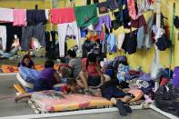 Residents rest at a shelter for people affected by the floods caused by heavy rain brought by Storm Iota, in San Pedro Sula