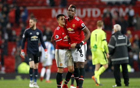 "<span>Pogba greets <a class=""link rapid-noclick-resp"" href=""/soccer/players/alexis-sánchez"" data-ylk=""slk:Alexis Sanchez"">Alexis Sanchez</a> at full-time against Huddersfield</span> <span>Credit: PA </span>"