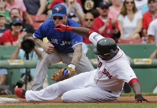 Boston Red Sox' David Ortiz beats the tag by Toronto Blue Jays third baseman Brett Lawrie as he advances on a double by teammate Cody Ross in the fourth inning of a baseball game at Fenway Park in Boston, Wednesday, June 27, 2012. (AP Photo/Charles Krupa)