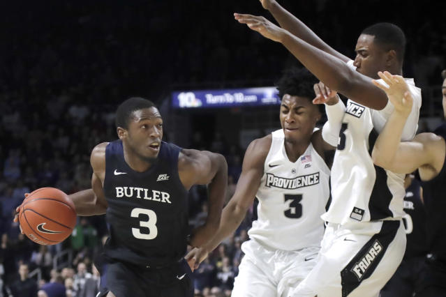 Butler guard Kamar Baldwin (3) drives against Providence guard David Duke (3) and forward Kalif Young, right, during the first half of an NCAA college basketball game Friday, Jan. 10, 2020, in Providence, R.I. (AP Photo/Elise Amendola)