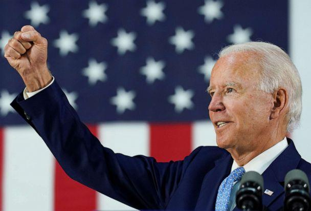 PHOTO: Democratic presidential candidate and former Vice President Joe Biden thrusts his fist while answering questions from reporters during a campaign event in Wilmington, Delaware, June 30, 2020. (Kevin Lamarque/Reuters, FILE)