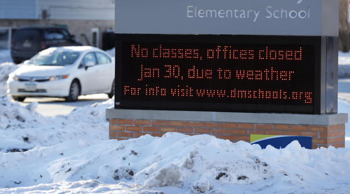 A car passes an elementary school closed due to cold weather, Jan. 30, 2019, in Des Moines, Iowa. (Photo: Charlie Neibergall/AP)