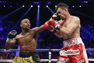 Floyd Mayweather Jr. lands a left jab against Robert Guerrero. (AP)