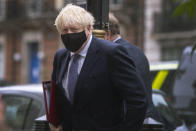 """Britain's Prime Minister Boris Johnson arrives at BBC Broadcasting House to appear on the Andrew Marr show, in London, Sunday, Oct. 4, 2020. Johnson has defended his handling of the coronavirus pandemic, but warned that the country faces a """"bumpy"""" winter ahead. Britain has Europe's highest coronavirus death toll, at more than 42,000, and Johnson's Conservative government is facing criticism from all sides. Opponents say tougher social restrictions are needed to suppress a second pandemic wave. (Victoria Jones/PA via AP)"""
