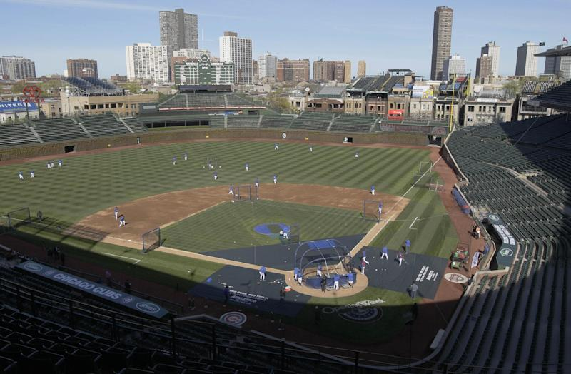 FILE - In this April 4, 2012, file photo, Chicago Cubs players work out at Wrigley Field in Chicago, the day before their opening day baseball game against the Washington Nationals. Chicago's Wrigley Field, New Orleans' Saenger Theatre and a historic Los Angeles' shipbuilding center have joined a list of sites being saved thanks to the efforts of historic preservationists in 2013. (AP Photo/Nam Y. Huh, File)