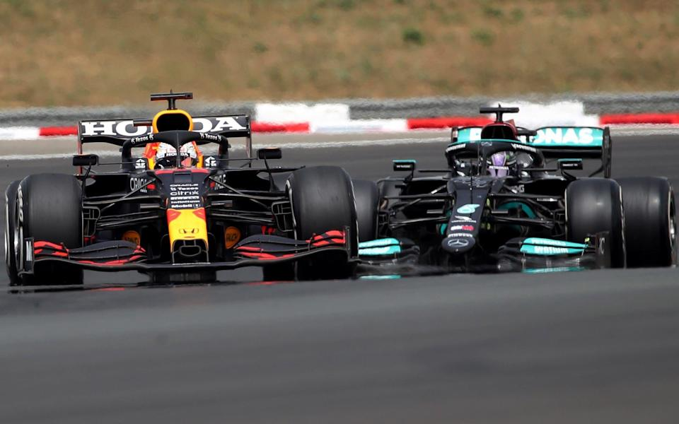 Circuit Paul Ricard, Le Castellet, France - June 20, 2021 Red Bull's Max Verstappen and Mercedes' Lewis Hamilton in action during the race - REUTERS/Yves Herman