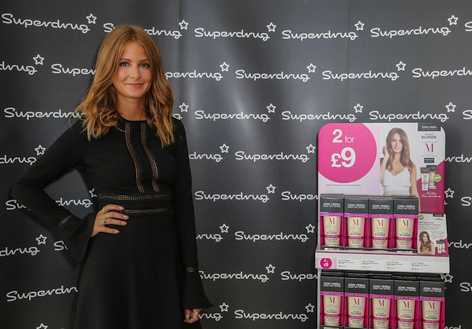LONDON, ENGLAND - AUGUST 24: Millie Mackintosh (wearing Millie Mackintosh dress and Aquazzura shoes) collaborates With John Frieda to launch an Exclusive Range on August 24, 2016 in London, England. (Photo by David M. Benett/Dave Benett/Getty Images for Superdrug)