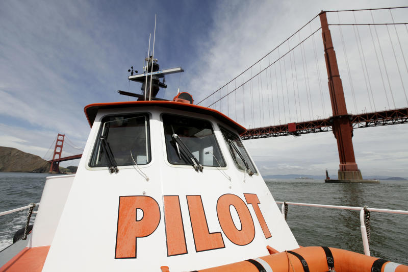 In this photo taken Wednesday April 25, 2012, a San Francisco Bar Pilot boat makes its way past the Golden Gate Bridge in San Francisco. Since the days of Mark Twain, the pilots have had it good. Thanks to political clout and highly specialized training, this cadre of 60 ship captains has for more than a century had control over guiding oil tankers and cargo ships in, out and around the San Francisco Bay. (AP Photo/Eric Risberg)