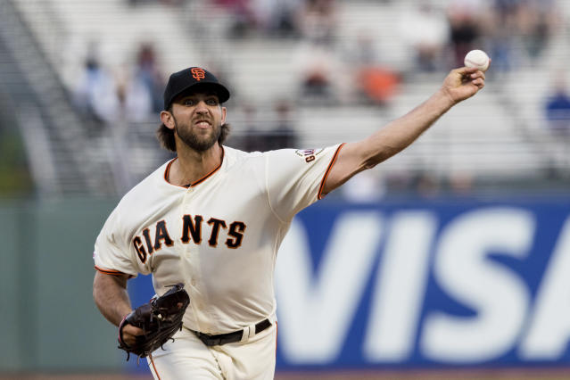 San Francisco Giants starting pitcher Madison Bumgarner throws against a Pittsburgh Pirates' batter in the first inning of a baseball game in San Francisco, Monday Sept. 9, 2019. (AP Photo/John Hefti)