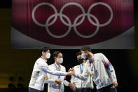South Korea gold medalists celebrate on the podium of the men's Sabre team medal at the 2020 Summer Olympics, Wednesday, July 28, 2021, in Chiba, Japan. (AP Photo/Andrew Medichini)