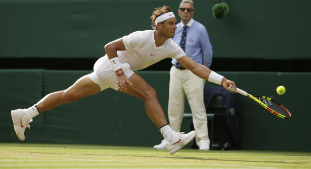 Rafael Nadal of Spain returns the ball to Czech Republic's Jiri Vesely during their men's singles match, on day seven of the Wimbledon Tennis Championships, in London, Monday July 9, 2018. (AP Photo/Tim Ireland)