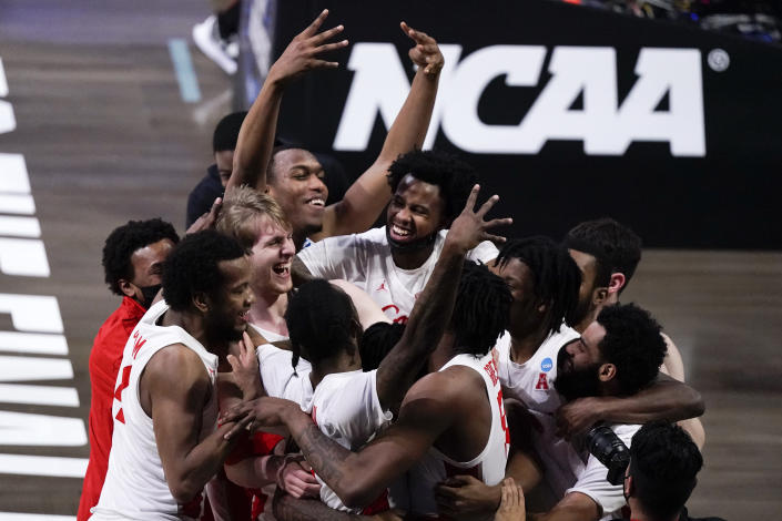 Houston players celebrate after beating Houston 67-61 during an Elite 8 game in the NCAA men's college basketball tournament at Lucas Oil Stadium, Monday, March 29, 2021, in Indianapolis. (AP Photo/Michael Conroy)
