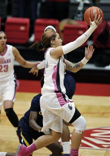Washington State guard Lia Galdeira (3) drives in for a layup during the first half of an NCAA college basketball game against California, Thursday, Feb. 28, 2013, at Beasley Coliseum in Pullman, Wash. (AP Photo/Dean Hare)