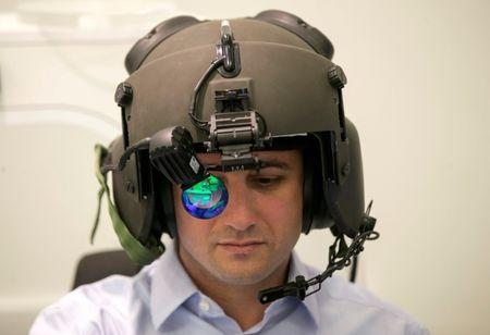 FILE PHOTO: A man demonstrates wearing Elbit System's advanced helmet mounted system, at their offices in Haifa