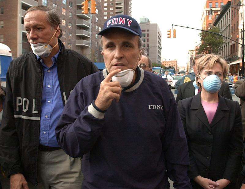 New York City Mayor Rudolph Giuliani, center, leads New York Gov. George Pataki, left, and Sen. Hillary Rodham Clinton, D-N.Y., on a tour of the site of the World Trade Center disaster on Sept. 12, 2001. (Robert F. Bukaty/AP)