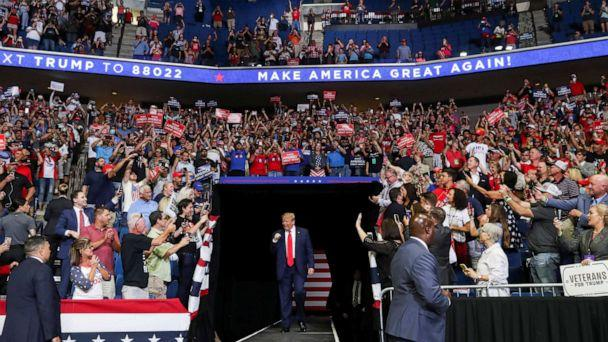 PHOTO: President Donald Trump pumps his fist as he enters his first re-election campaign rally in several months in the midst of the coronavirus disease (COVID-19) outbreak, at the BOK Center in Tulsa, Oklahoma, June 20, 2020. (Leah Millis/Reuters)