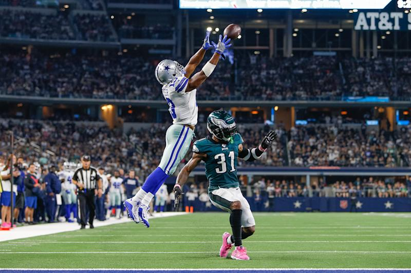 Dallas Cowboys wide receiver Amari Cooper (19) makes a catch over Philadelphia Eagles cornerback Jalen Mills (31), though it was called back due to a penalty. (Getty Images)