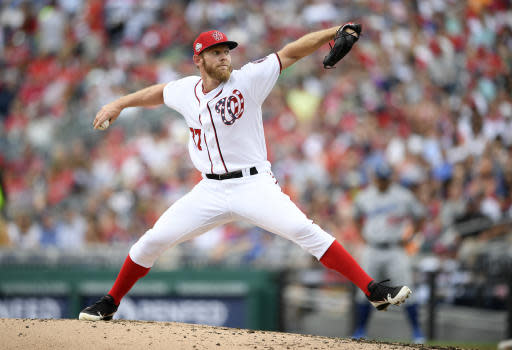 Washington Nationals starting pitcher Stephen Strasburg delivers during the third inning of a baseball game against the Los Angeles Dodgers, Sunday, May 20, 2018, in Washington. (AP Photo/Nick Wass)