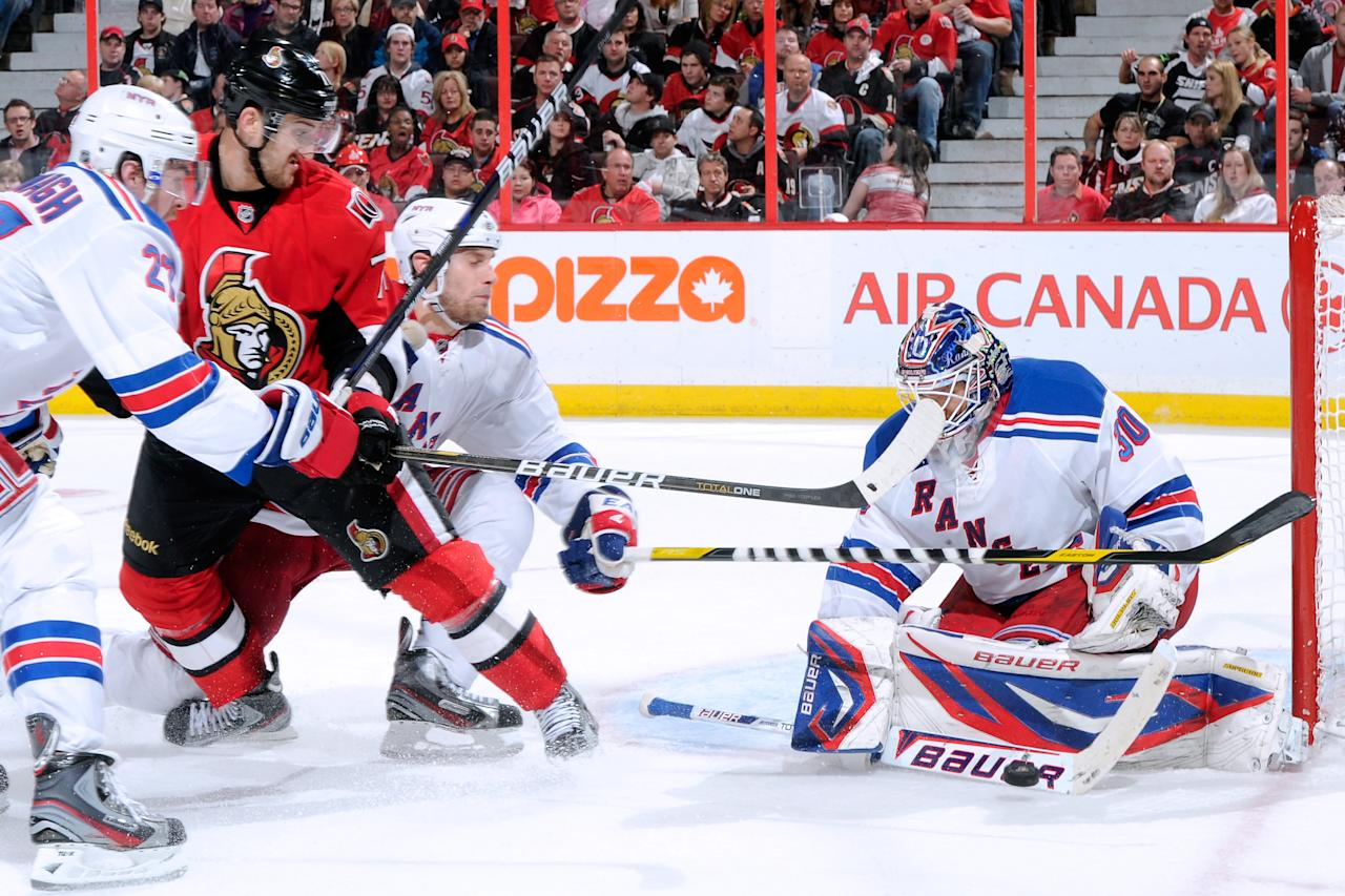 OTTAWA, CANADA - APRIL 23:  Henrik Lundqvist #30 of the New York Rangers stops the puck on an attempt by Nick Foligno #71 of the Ottawa Senators in Game Six of the Eastern Conference Quarterfinals during the 2012 NHL Stanley Cup Playoffs at the Scotiabank Place on April 23, 2012 in Ottawa, Ontario, Canada.  (Photo by Richard Wolowicz/Getty Images)