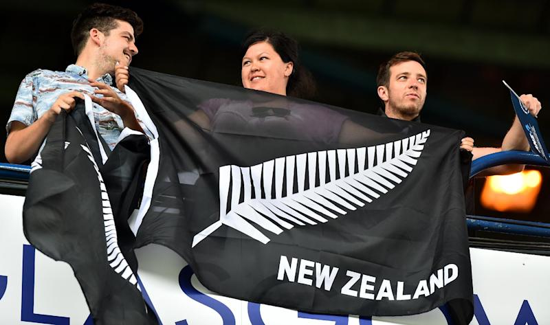 Fans hold a New Zealand flag during the Rugby Sevens pool matches at Ibrox Stadium during the 2014 Commonwealth Games in Glasgow on July 26, 2014 (AFP Photo/Ben Stansall)