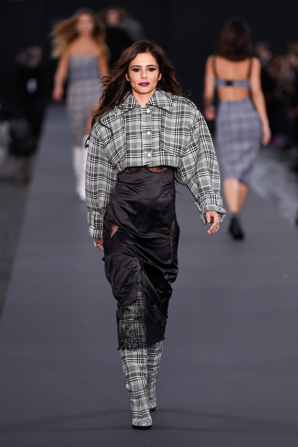 <p>Cheryl made her first public debut since giving birth in a boxy checked shirt and super high-waisted trousers. <i>[Photo: Getty]</i> </p>