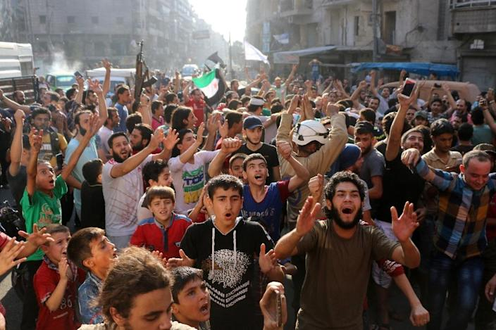 Celebrations after rebels said they have broken a three-week government siege on Aleppo (AFP Photo/Thaer Mohammed)