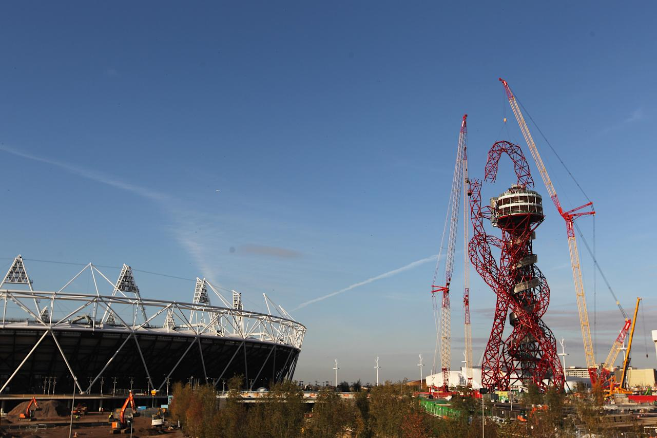 LONDON, ENGLAND - OCTOBER 28:  A general view of the Olympic Stadium as builders work on lowering the final piece to get the London 2012 ArcelorMittal Orbit sculpture completed at the Olympic Park on October 28, 2011 in London, England.  (Photo by Dean Mouhtaropoulos/Getty Images)