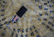 """A joint services honor guard carries the flag-draped casket of U.S. Capitol Police officer William """"Billy"""" Evans, to a catafalque where he will lie in honor at the Capitol in Washington, Tuesday, April 13, 2021. (Mandel Ngan/Pool via AP)"""