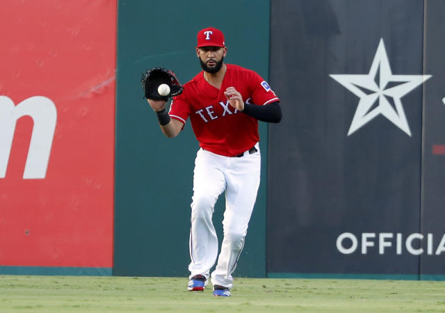 Texas Rangers' Nomar Mazara fields a run-scoring single by Los Angeles Angels' Kole Calhoun in the first inning of baseball game in Arlington, Texas, Monday, Aug. 19, 2019. Shohei Ohtani scored on the hit. (AP Photo/Tony Gutierrez)