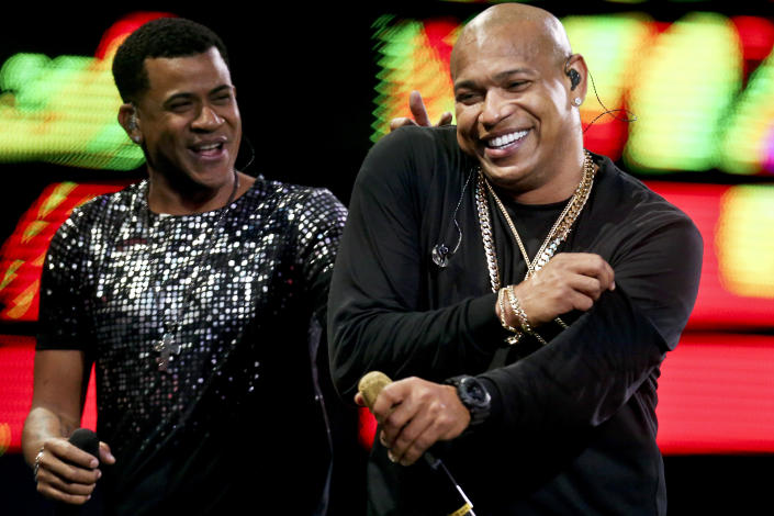 """FILE - In this Feb. 22, 2018 file photo, Randy Malcom Martinez and Alexander Delgado of the Cuban duo """"Gente de Zona"""" perform during the Vina del Mar International Song Festival at the Quinta Vergara coliseum in Vina del Mar, Chile. Platinum-selling reggaeton act Gente de Zona were barred from a New Year's Eve concert in a Miami park on Dec. 31, 2019. As President Donald Trump tightens the trade embargo on Cuba, some members of the United States' largest Cuban-American community are once again taking a hard line on performers like Gente de Zona who support its communist government or don't speak out against it. (AP Photo/Esteban Felix, File)"""