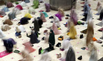"In this photo taken using slow shutter speed, Muslim women offer an evening prayer called ""tarawih"" marking the first eve of the holy fasting month of Ramadan at Istiqlal Mosque in Jakarta, Indonesia. Monday, April 12, 2021. During Ramadan, the holiest month in Islamic calendar, Muslims refrain from eating, drinking, smoking and sex from dawn to dusk. (AP Photo/ Achmad Ibrahim)"