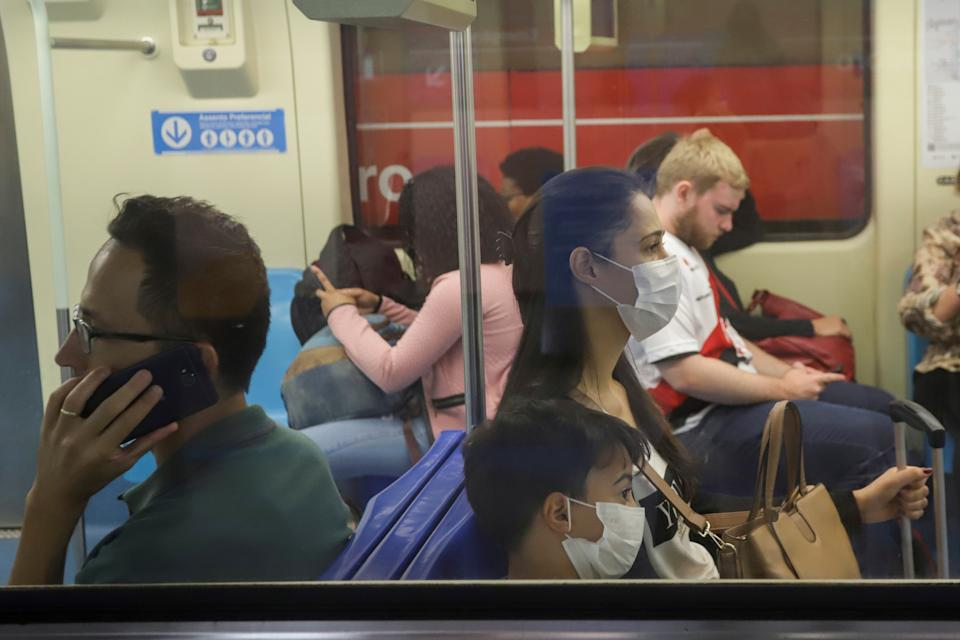People wear protective face masks at a subway after reports of the coronavirus in Sao Paulo, Brazil,  March 6, 2020. REUTERS/Rahel Patrasso