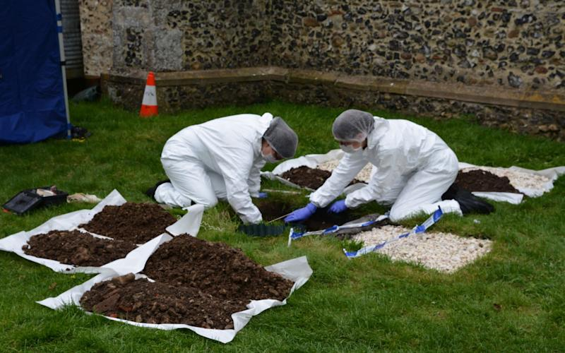 Forensic experts are now examining human bones found in the grave - Credit: SWNS