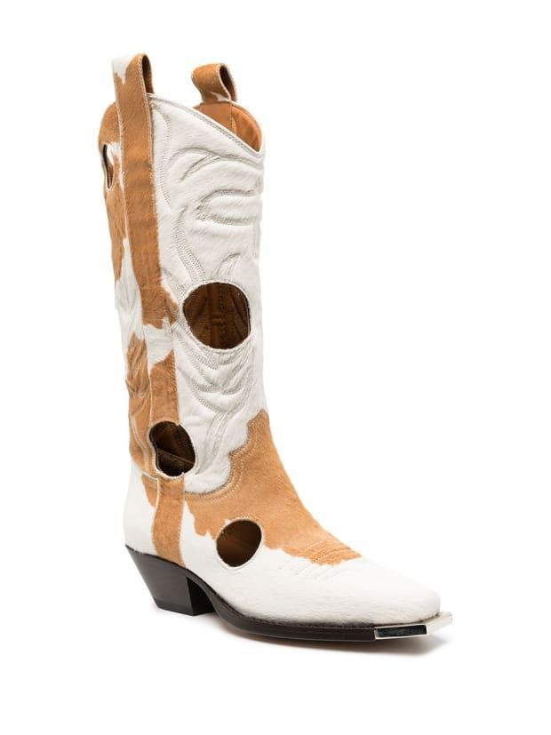"""<p>Off-White Two-tone Cowboy Boots, $1,966 (from $2,184), <a href=""""https://rstyle.me/+uwF0e1MoBFtNWvkhKTiqXA"""" rel=""""nofollow noopener"""" target=""""_blank"""" data-ylk=""""slk:available here"""" class=""""link rapid-noclick-resp"""">available here</a>. </p>"""