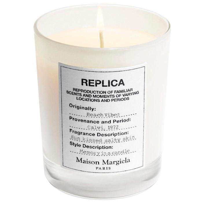 """<p><strong>Maison Margiela</strong></p><p>sephora.com</p><p><strong>$62.00</strong></p><p><a href=""""https://go.redirectingat.com?id=74968X1596630&url=https%3A%2F%2Fwww.sephora.com%2Fproduct%2Fmaison-margiela-replica-beach-vibes-scented-candle-P466666&sref=https%3A%2F%2Fwww.bestproducts.com%2Fbeauty%2Fg256%2Fchristmas-holiday-beauty-gifts%2F"""" rel=""""nofollow noopener"""" target=""""_blank"""" data-ylk=""""slk:Shop Now"""" class=""""link rapid-noclick-resp"""">Shop Now</a></p><p>Maison Margiela's REPLICA fragrances are a staple to just about any aroma-phile's vanity, so this candle will definitely impress any beauty fanatic. This scent in particular is our favorite for its nautical blend of bergamot, heliotrope, and coconut milk.</p>"""