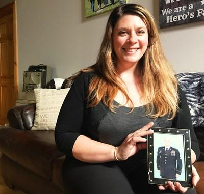 Jenni Allman holds a photo of her husband, First Sgt. Steven Allman, who is currently deployed to the Middle East. To honor Sgt. Allman as a Bryant True Hero, Chapman Heating and Air Conditioning, the 2017 Bryant Dealer of the Year, installed a donated Bryant Evolution home comfort system in the family's home.